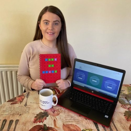 Marketing Trainee Frances from St Mary's University College on placement with Training Matchmaker pictured with Make It Click workbook