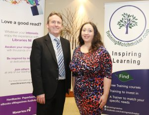 Libraries Northern Ireland CEO Jim O'Hagan with Chartered Marketer Christine Watson founder of Training Matchmaker dot com pictured at Get Blogging NI celebration event